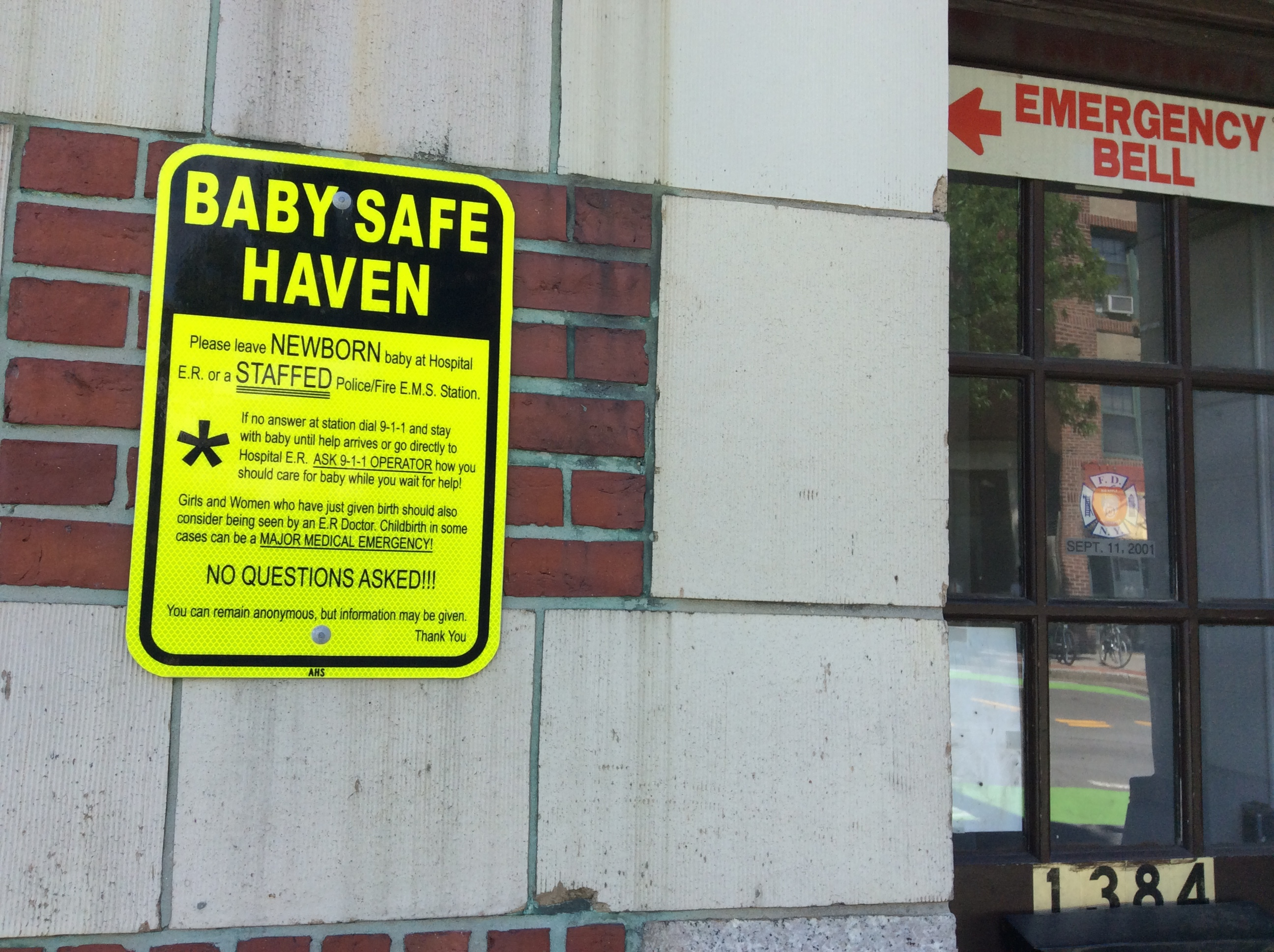 Photo: Outside of firestation, photo of Safe haven signage and direction to doorbell. (Detailed, lengthy info on sign.)