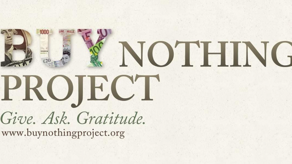 "Image of Buy Nothing Project banner. The word ""Buy"" is colorful, with images of objects."